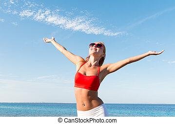 Cheerful young woman at the sea