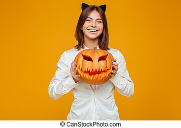 Cheerful young woman dressed in crazy cat halloween costume