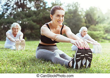Cheerful young woman enjoying sport