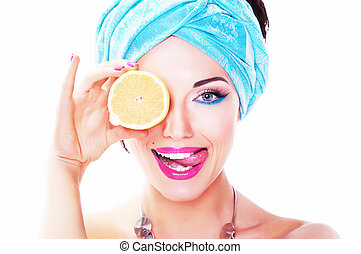 Cheerful young woman holding juicy delicious lemon (orange). Natural organic food concept