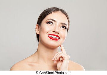 Cheerful young woman in braces portrait