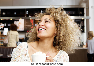 Cheerful young woman in cafe