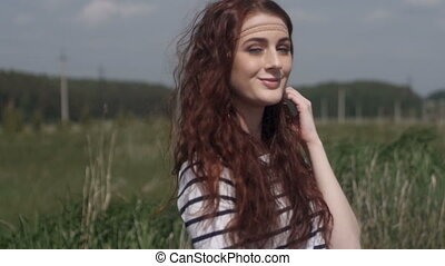 Cheerful young woman on meadow