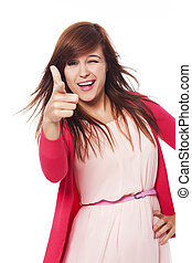 Cheerful young woman pointing at camera