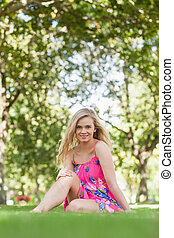 Cheerful young woman sitting on a