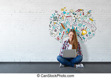 Cheerful young woman sitting on floor and using laptop in white brick interior with business sketch on wall. Education concept. 3D Rendering