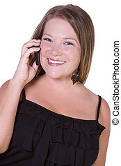 Cheerful young woman smiling while  chatting on phone