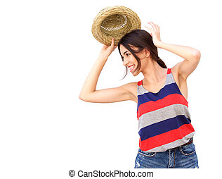 Cheerful young woman smiling with hat against white background