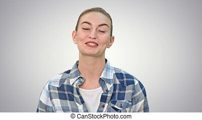 Cheerful young woman talking to a camera. Close up on white background. 076w. You can use it e.g. in your commercial video, business, medical presentation, broadcast video.