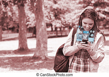 Cheerful young woman texting on he