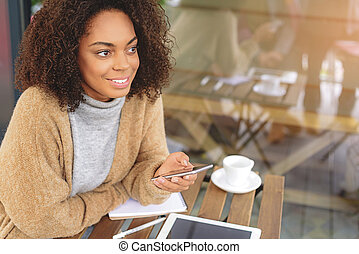 cheerful young woman using a cellphone - businesswoman with...