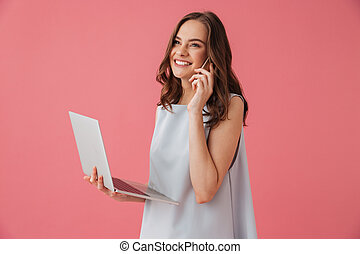 Cheerful young woman using laptop computer