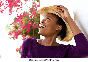 Cheerful young woman with hat
