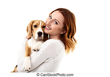 Cheerful young woman with her pretty dog - Attractive girl...