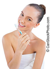Cheerful young woman with toothbrush
