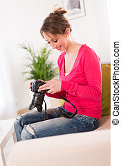 cheerful young women photographer