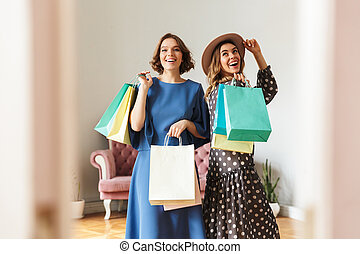 Cheerful young women shopaholics