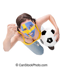cheerfully female swedish soccer fan with a football