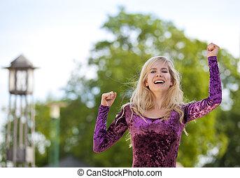 cheering blond fashion model