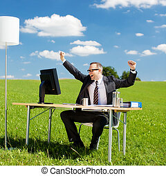 Cheering businessman - Happy businessman sitting and...