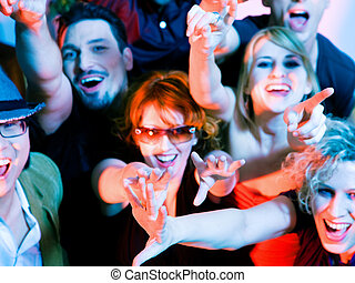 Cheering crowd in disco club - Crowd cheering - their rock ...