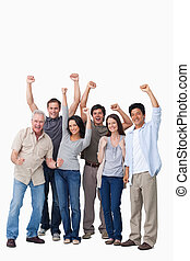Cheering group of people against a white background