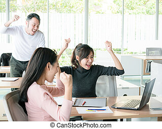 Cheering happy business people ,Happy business team with arm raised sitting at desk in office during an office monthly meeting success, business concept background ,Activity moving blurred