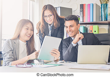 Cheering happy business people ,Happy business team with arm raised sitting in office during an office monthly meeting success, business concept background ,Activity moving blurred concept