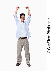Cheering male with arms up against a white background