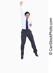 Cheering tradesman with raised arm against a white ...