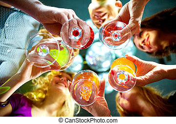 Cheering up - Below view of people clinking glasses with...