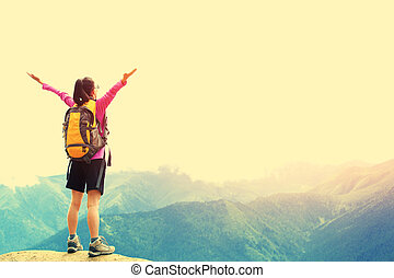 cheering woman hiker open arms at m