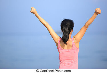 cheering woman on beach