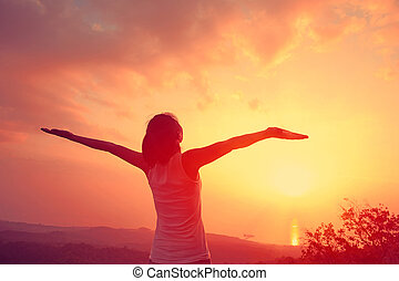cheering woman open arms mountain peak