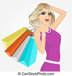 cheering young woman with shopping bags