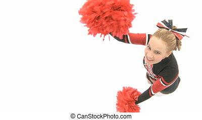 Cheerleader is dancing and looks up