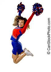 Cheerleader Jumping - Uniformed cheerleader jumps high in...