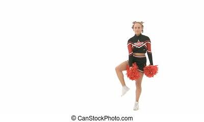 Cheerleader Kick - Cheerleader raises her right leg over her...