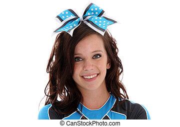 Cheerleader - Teenage cheerleader with uniform on a white...