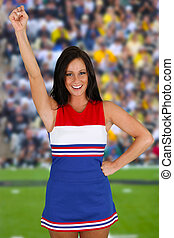 Cheerleader with uniform on at a football game