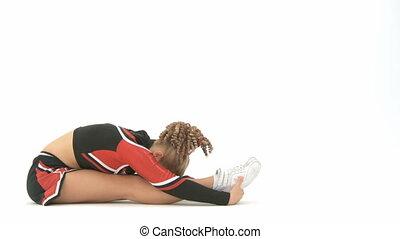 Cheerleader stretches - Cheerleader stretching her legs