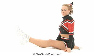 Cheerleader throws an air kiss - Cheerleader make the split...