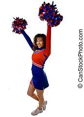 Cheerleader with pom poms - Uniformed cheerleader strikes a...