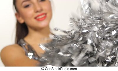 Cheerleader with pompoms, full length portrait of happy smile, slow motion