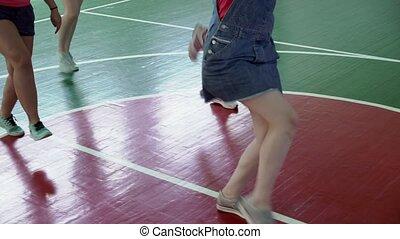 Cheerleaders dancing in sports hall