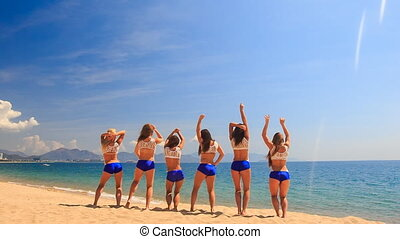 cheerleaders from backside perform Back Tuck Basket Toss on...