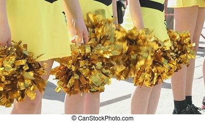 Cheerleaders girls dressed in yellow costumes