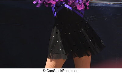 Cheerleaders in purple suits with Pom-Poms