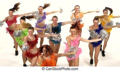 Cheerleading, girls dancing smiling at the camera, camera...