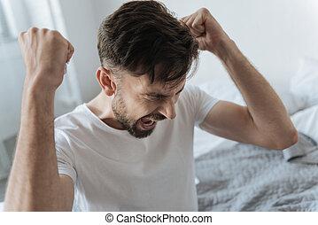Cheerless angry man having a failure